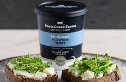 Paris Creek Farms Quark served with herbs. Quark is a soft set fresh cheese product.