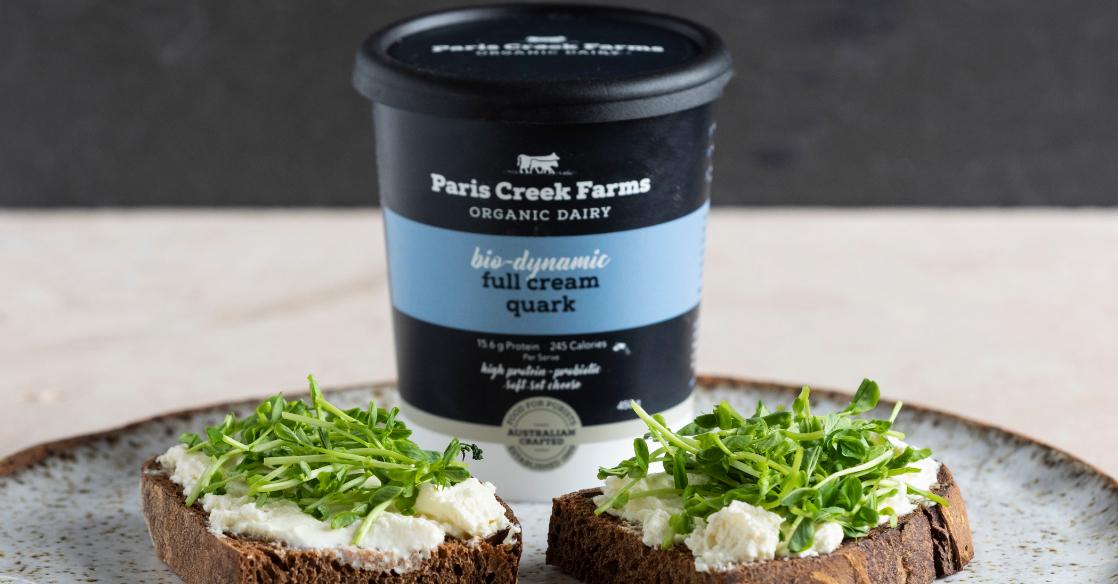 Paris Creek Farms Quark served with herbs. Quark is a soft set fresh cheese product.